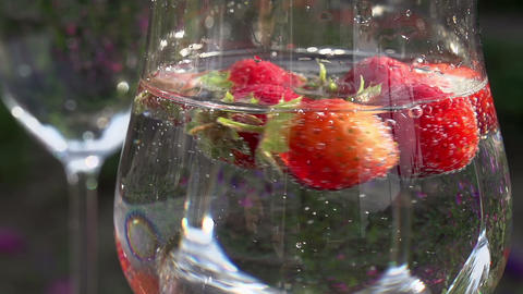 Strawberry Rotates in a Glass with Water Footage