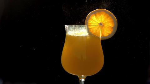 Ice Cubes in Orange Juice S HD Footage