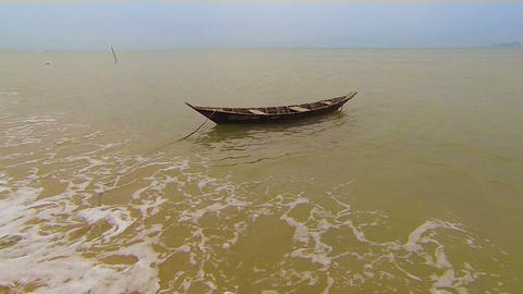 1920x1080 video - Lonely small wooden boat anchore Footage