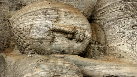 Ancient statue of lying Buddha carved out of rock Footage