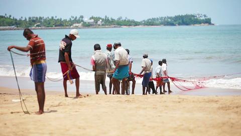 HIKKADUWA. SRI LANKA - APR 26: Local fishermen pul Footage