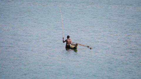 BENTOTA. SRI LANKA - APR 28: Man in small wooden b Footage