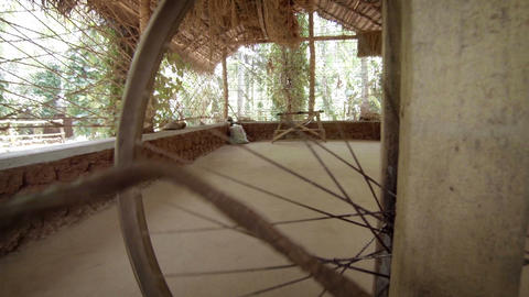 The old spinning wheel in the eastern village Footage