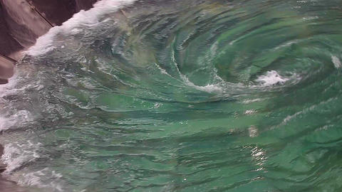 Man-made huge whirlpool - glass bowl with moving w Footage