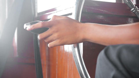 Hand of the driver of the old riverboat Footage