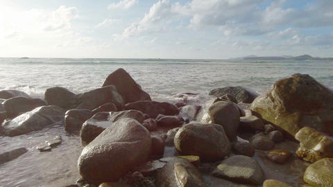 Sea surf and large rocks on the shore Footage