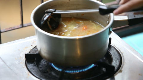 Stirred Ladle Chicken Soup In Saucepan On Gas Stov stock footage