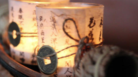 Two candles wrapped in chinese paper Footage