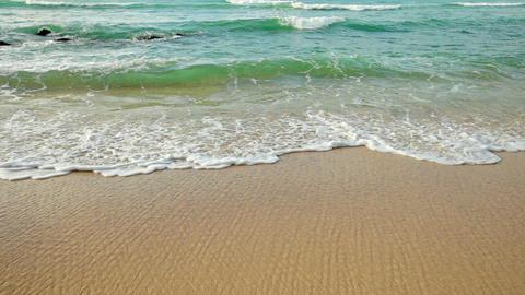 Sea surf on a tropical sandy beach. close up Footage