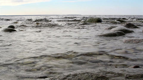 Small waves on the sea with rocks Footage