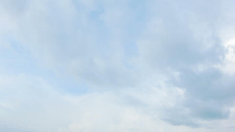 The clouds slowly moving in the daytime sky Footage