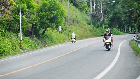 PHUKET. THAILAND - NOV 9: Motorbikes and cars move Footage
