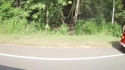 KANDY. SRI LANKA - APR 15: Common red tuk-tuk tran Footage