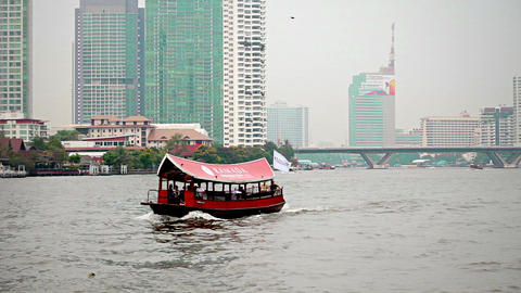 BANGKOK - APR 10: Tourist ferry boat crosses a riv Footage