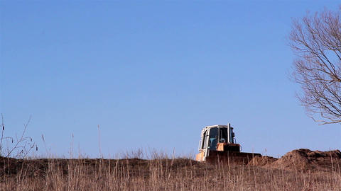 The Caterpillar Tractor Getting Some Soil stock footage