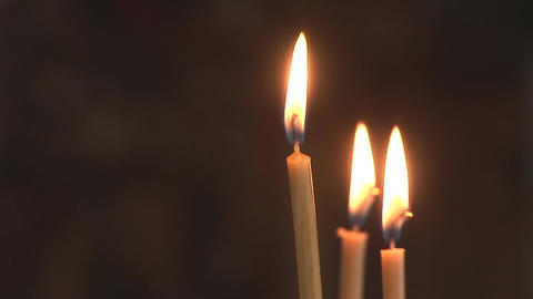 three lighting candles Stock Video Footage
