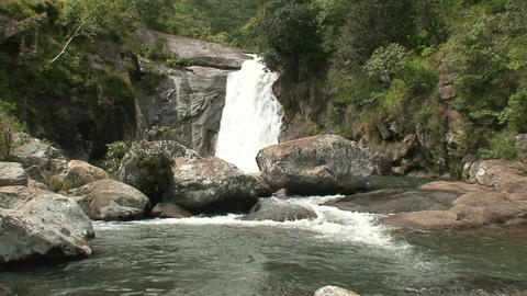 Malawi: waterfall in a rock hill at noon 1 Footage