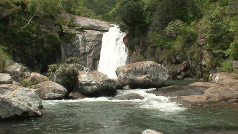 Malawi: waterfall in a rock hill at noon 1 Stock Video Footage