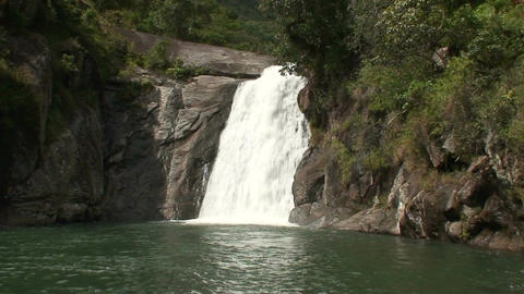 Malawi: waterfall in a rock hill at noon 4a Footage