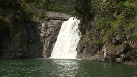 Malawi: waterfall in a rock hill at noon 4a Stock Video Footage