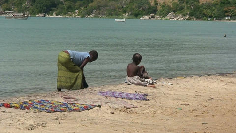 Malawi: poor people washing loundry in a lake Footage