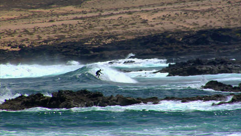 dangerous surfing between lava rocks 2 Footage