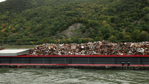 Transporting recycle dump with a ship on Rhine river 1 Stock Video Footage