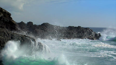 crushing waves on lava island Stock Video Footage