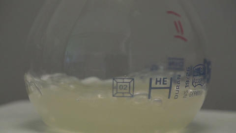 Boiling chemicals inside the flask Footage