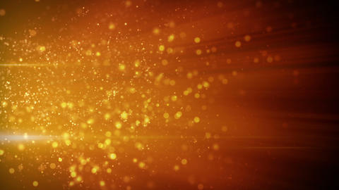 springing gold particles in light beams loop Animation