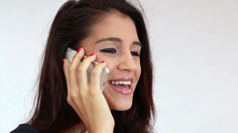 Young Mediterranean Woman Chatting on the Phone Live Action