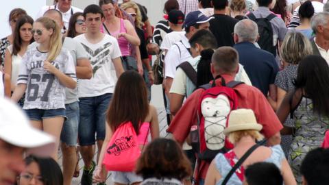 Crowd Crossing Maremagnum Bridge in Barcelona Live Action