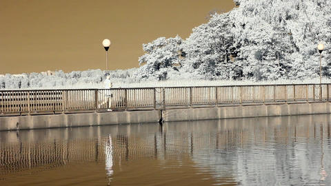 Infrared Finland: girl jogging on a bridge 1 Stock Video Footage