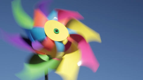 Child's windmill against blue sky Stock Video Footage