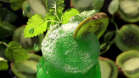 In the Glass Pours a Green Smoothie Footage