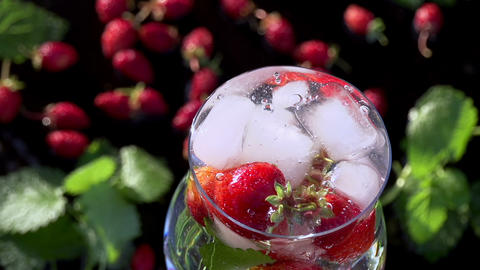 Ice Cubes Falling into Berry Drink Footage