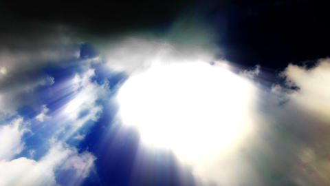 Sun beams streak from billowing time lapse clouds - Cloud... Stock Video Footage