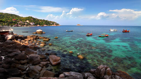 Rocky shore and boats loop Stock Video Footage