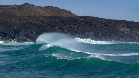 huge cyan wave spray rainbow vulcan beach Stock Video Footage
