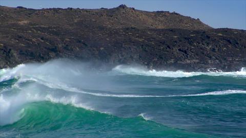 huge cyan wave spray rainbow vulcan beach Footage