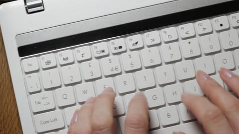 Tracking laptop keyboard Stock Video Footage
