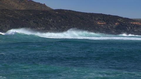huge cyan wave spray vulcan beach a Stock Video Footage