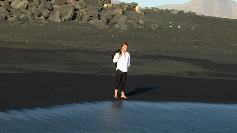 business man thinking walk water black beach Footage
