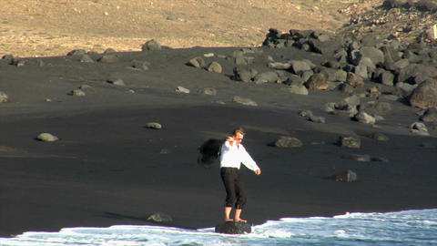 business man toss jacket black beach Footage