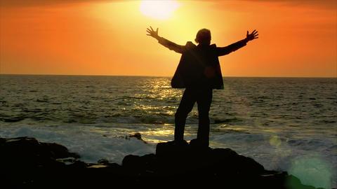 business man reach hands sundown sky Stock Video Footage