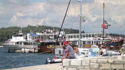Tourists walking at Rovinj harbor, Croatia Stock Video Footage