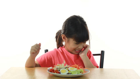 young girl doesn't like eating vegetables Footage