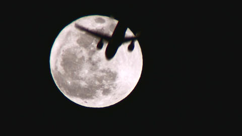 Full Moon And Plane Crossing stock footage