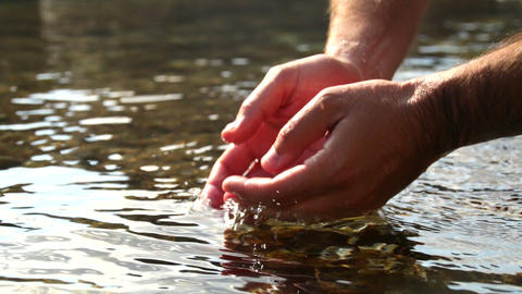 Collecting Water with Hands in the Sea Footage