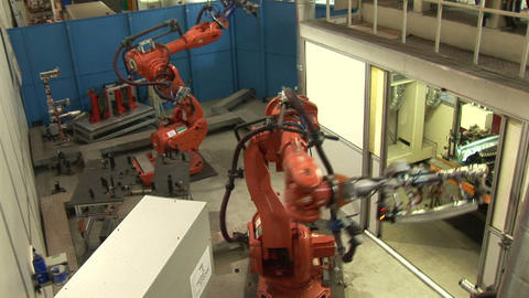 Industrial Robots On An Assembly Line stock footage